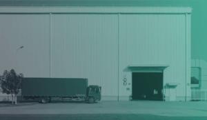 logistics-truck-outside-warehouse